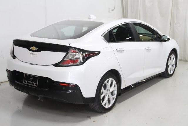 What to drive in retirement -- a 106 eMPG 2017 Chevrolet Volt Premier in pearl white, right rear three-quarters view. Shows the high aero-efficient tail. But also demonstrates need for Chevy's included driver-aid technologies to deal with poor rear visibility.